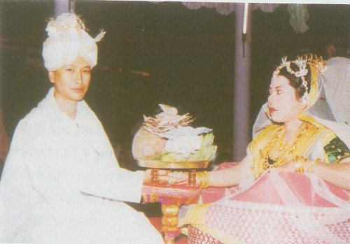 Bride and Bridegroom holding the Kujapot : from N Mangi Devi's book